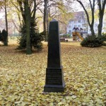 black tombstone and playground