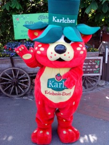 "Karlchen, the friendly ""strawbeary"" at the entrance/exit of Karl's"